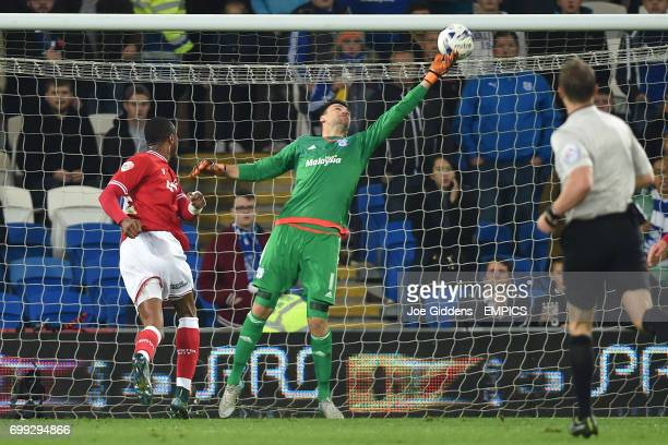 Cardiff City goalkeeper David Marshall tips the ball over the bar after a shot from Bristol City's Jonathan Kodjia
