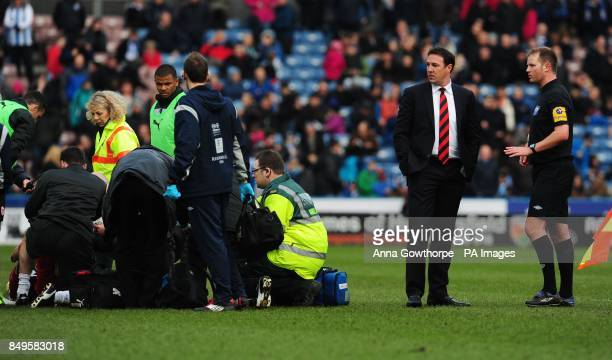 Cardiff City manager Malky Mackay talks to referee Mark Brown as Cardiff's Kevin McNaughton is treated for an injury during the npower Football...