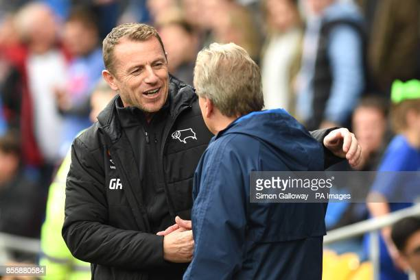 Cardiff City manager Neil Warnock and Derby County manager Gary Rowett during the Sky Bet Championship match at Cardiff City Stadium