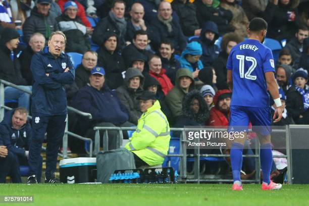 Cardiff City manager Neil Warnock talks to Liam Feeney of Cardiff City during the Sky Bet Championship match between Cardiff City and Brentford at...