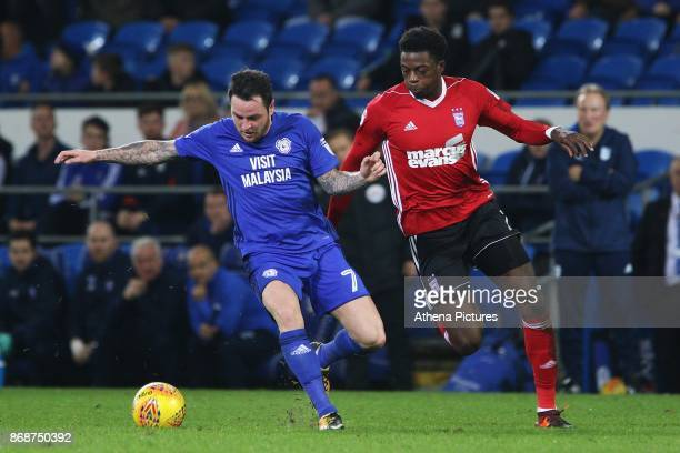 Cardiff City manager Neil Warnock watches on as Lee Tomlin of Cardiff City is marked by Dominic Iorfa of Ipswich during the Sky Bet Championship...