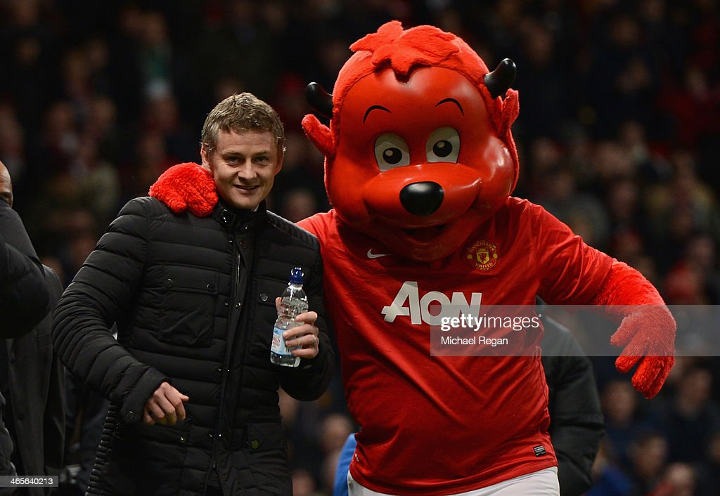 Cardiff City Manager <a gi-track='captionPersonalityLinkClicked' href=/galleries/search?phrase=Ole+Gunnar+Solskjaer&family=editorial&specificpeople=201769 ng-click='$event.stopPropagation()'>Ole Gunnar Solskjaer</a> is greeted by mascot Fred the Red prior to the Barclays Premier League match between Manchester United and Cardiff City at Old Trafford on January 28, 2014 in Manchester, England.