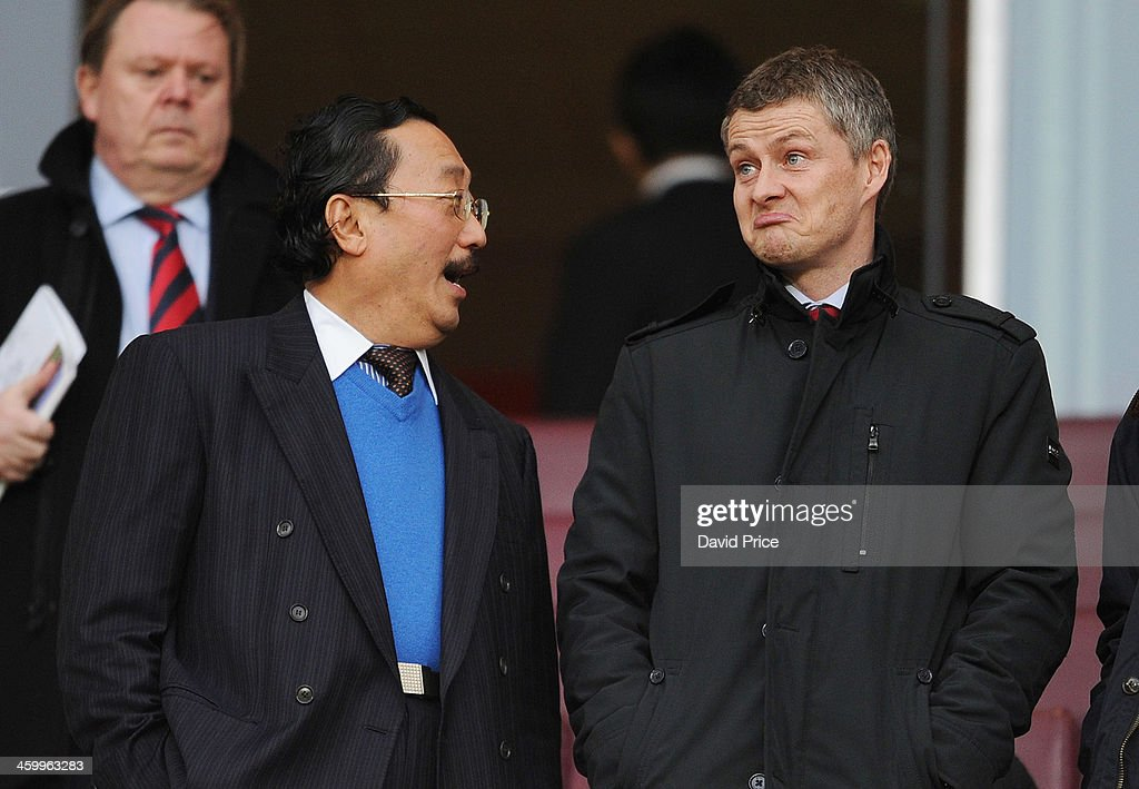 Cardiff City Owner Vincent Tan chats to <a gi-track='captionPersonalityLinkClicked' href=/galleries/search?phrase=Ole+Gunnar+Solskjaer&family=editorial&specificpeople=201769 ng-click='$event.stopPropagation()'>Ole Gunnar Solskjaer</a> before the match Arsenal against Cardiff City in the Barclays Premier League at Emirates Stadium on January 1, 2014 in London, England.