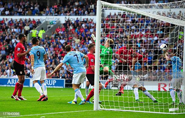 Cardiff City player Fraizer Campbell heads in the second Cardiff goal during the Barclays Premier League match between Cardiff City and Manchester...