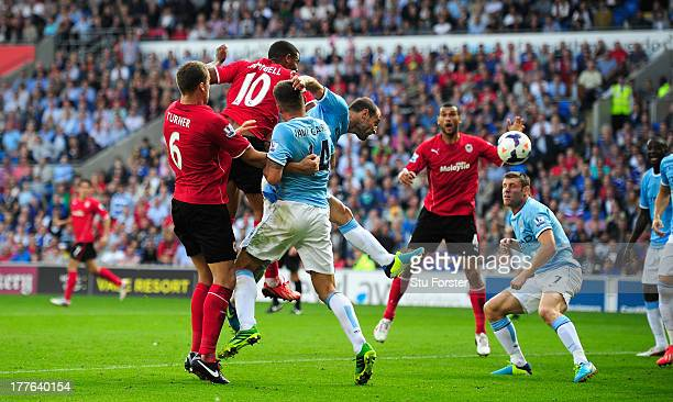 Cardiff City player Fraizer Campbell heads in the third Cardiff goal during the Barclays Premier League match between Cardiff City and Manchester...
