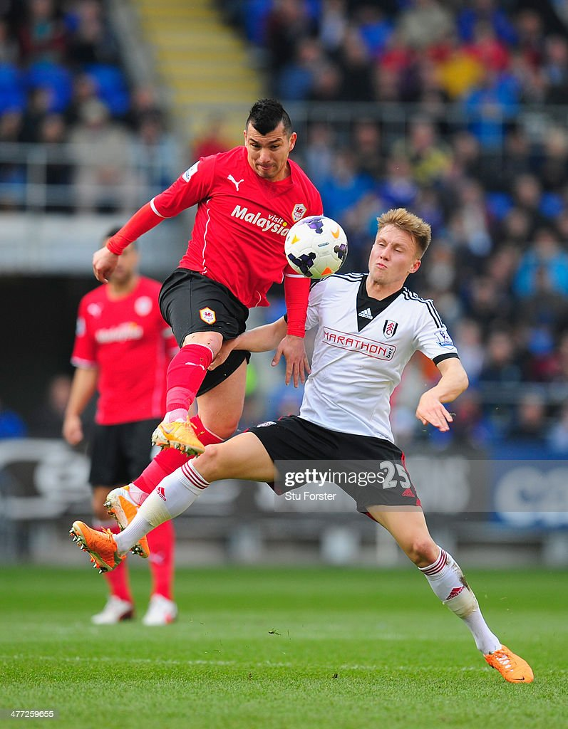 Cardiff City player <a gi-track='captionPersonalityLinkClicked' href=/galleries/search?phrase=Gary+Medel&family=editorial&specificpeople=4123504 ng-click='$event.stopPropagation()'>Gary Medel</a> (l) challenges Cauley Woodrow of Fulham during the Barclays Premier league match between Cardiff City and Fulham at Cardiff City Stadium on March 8, 2014 in Cardiff, Wales.