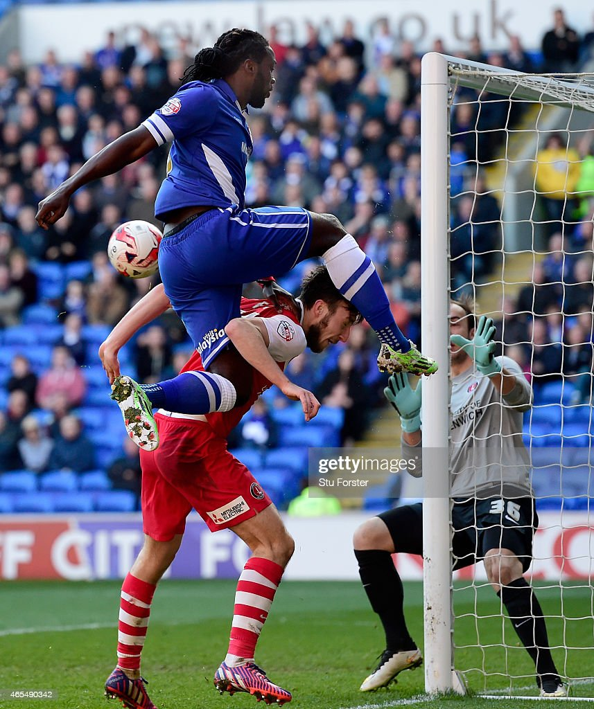 Cardiff City player <a gi-track='captionPersonalityLinkClicked' href=/galleries/search?phrase=Kenwyne+Jones&family=editorial&specificpeople=553966 ng-click='$event.stopPropagation()'>Kenwyne Jones</a> beats Morgan Fox of Charlton to the ball to set up the first goal during the Sky Bet Championship match between Cardiff City and Charlton Athletic at Cardiff City Stadium on March 7, 2015 in Cardiff, Wales.