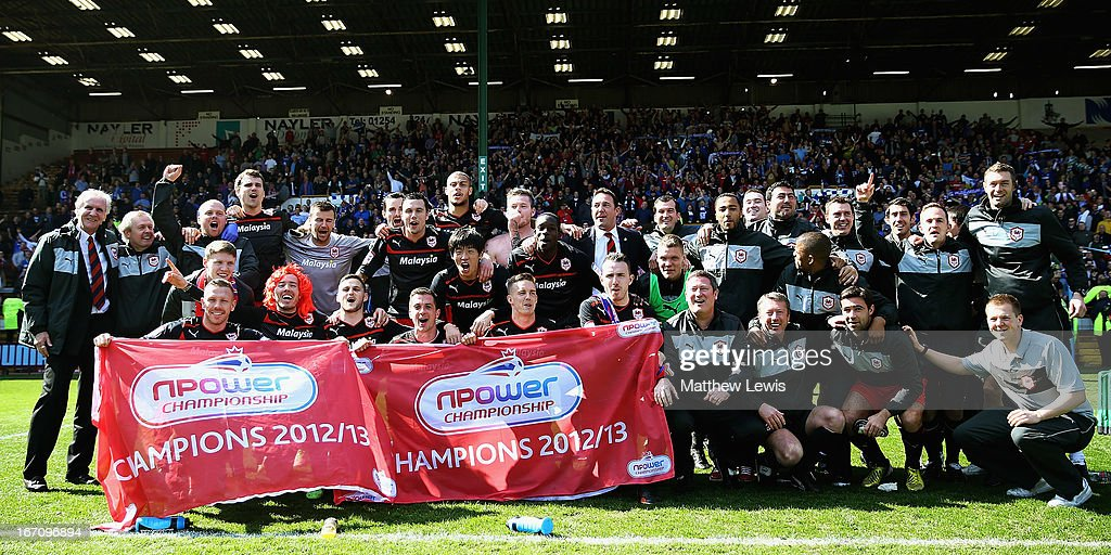 Cardiff city players celebrate going up to the Premiership after the npower Championship match between Burnley and Cardiff City at Turf Moor on April 20, 2013 in Burnley, England.