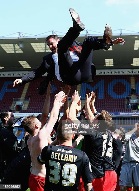 Cardiff city players celebrate going up to the Premiership by throwing their manager Malky MacKay in the air during the npower Championship match...