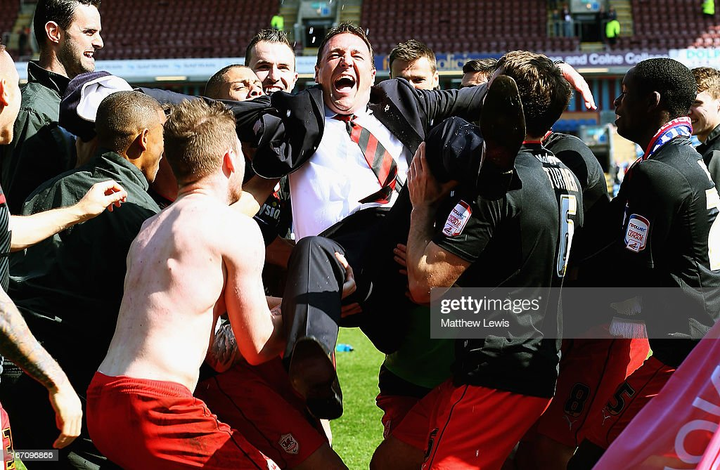 Cardiff city players celebrate going up to the Premiership by throwing their manager Malky MacKay in the air during the npower Championship match between Burnley and Cardiff City at Turf Moor on April 20, 2013 in Burnley, England.