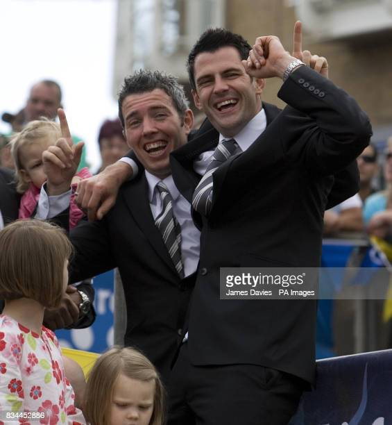 Cardiff City players Kevin McNaughton and Steve Thompson react to the crowds' cheers as the Cardiff squad take to the stage at Plass Roald Dahl...
