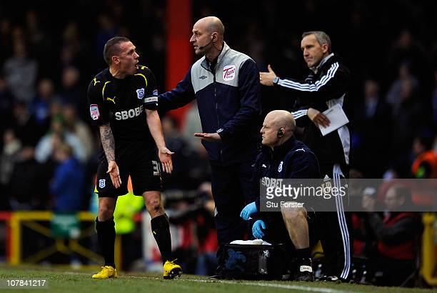Cardiff City striker Craig Bellamy argues with the fourth official during the npower Championship match between Bristol City and Cardiff City at...