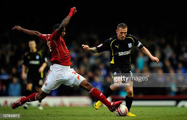 Cardiff City striker Craig Bellamy skips past the challenge of Bristol City player Marvin Elliott during the npower Championship match between...