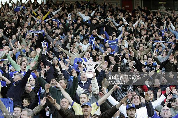 Cardiff City supporters celebrate beating Middlesbrough 20 in their English FA Cup quarter final football match at The Riverside Stadium...