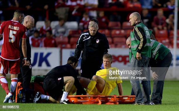 Cardiff City's Andreas Cornelius is stretchered off against Accrington Stanley during the Capital One Cup Second Round match at the Crown Ground...