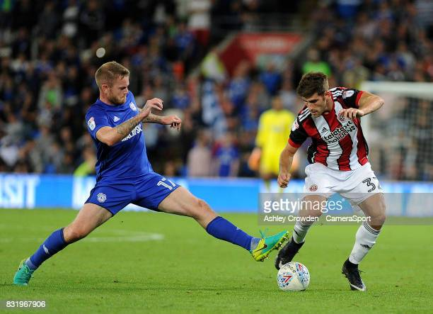 Cardiff City's Aron Gunnarsson battles with Sheffield United's Ched Evans during the Sky Bet Championship match between Cardiff City and Sheffield...