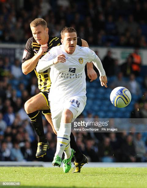 Cardiff City's Ben Turner and Leeds United's Ross McCormack battle for the ball