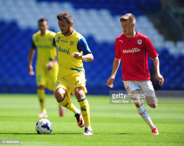 Cardiff City's Craig Noone and Chievo Verona's Cyril Thereau battle for the ball