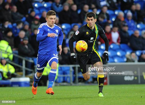 Cardiff City's Declan John vies for possession with Norwich City's Nelson Oliveira during the Sky Bet Championship match between Cardiff City and...