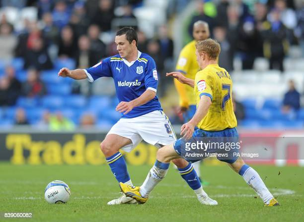 Cardiff City's Don Cowie and Birmingham City's Chris Burke in action