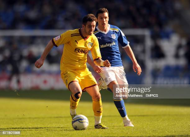 Cardiff City's Don Cowie and Burnley's Danny Ings battle for the ball