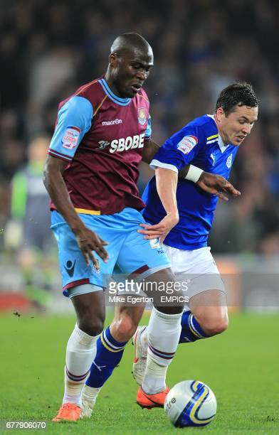 Cardiff City's Don Cowie and West Ham United's Guy Demel battle for the ball