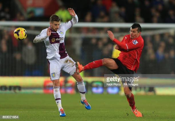 Cardiff City's Gary Medel and Aston Villa's Joe Bennett battle for the ball during the Barclays Premier League match at the Cardiff City Stadium...