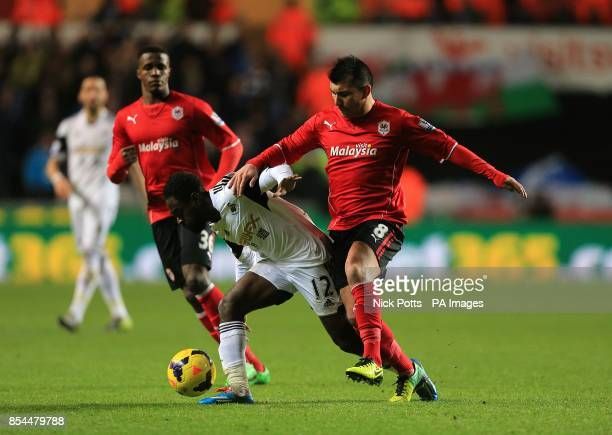 Cardiff City's Gary Medel and Swansea City's Nathan Dyer battle for the ball