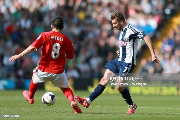 Cardiff City's Gary Medel and West Bromwich Albion's James Morrison battle for the ball