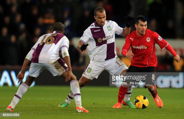 Cardiff City's Gary Medel holds off a challenge from Aston Villa's Gabriel Agbonlahor