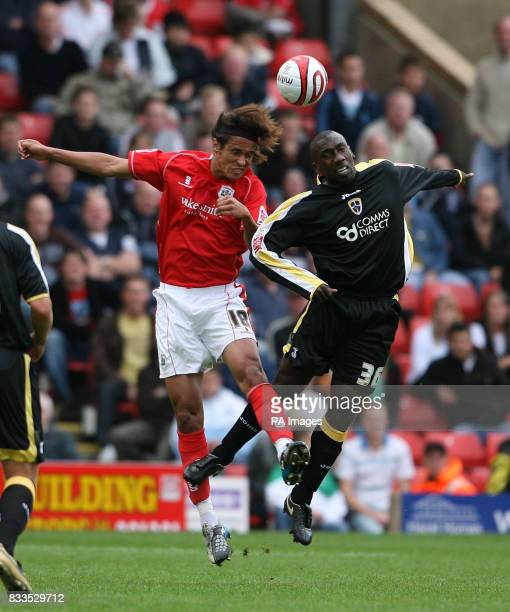 Cardiff City's Jimmy Floyd Hasselbaink and Barnsley's Dennis Souza during the CocaCola Football League Championship match at the Oakwell Ground...