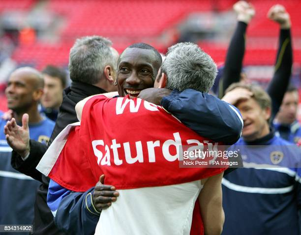Cardiff City's Jimmy Floyd Hasselbaink and Kevin McNaughton celebrate after the final whistle