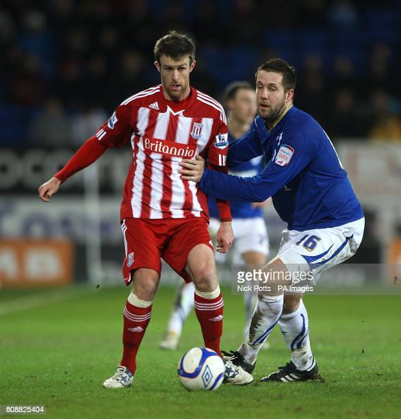 Cardiff City's Jon Parkin and Stoke City's Michael Tonge battle for the ball