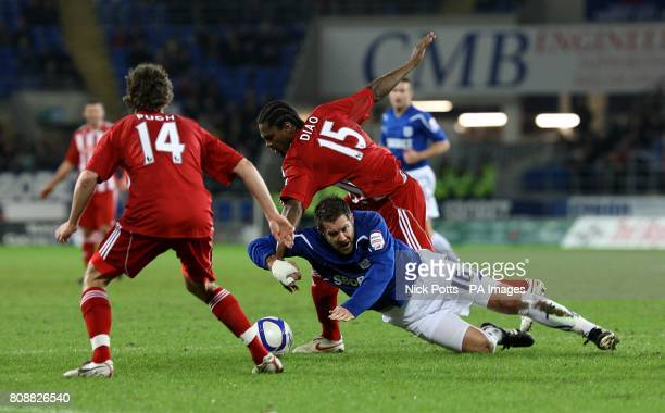 Cardiff City's Jon Parkin and Stoke City's Salif Diao collide as they battle for the ball