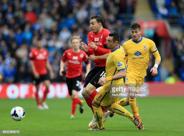 Cardiff City's Jordon Mutch and Crystal Palace's Damien Delaney battle for the ball