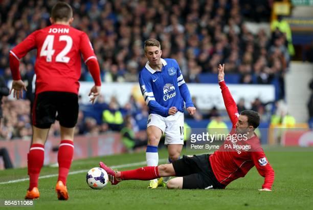 Cardiff City's Jordon Mutch slides in to challenge Everton's Gerard Deulofeu