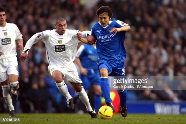 Cardiff City's Junichi Inamoto and Leeds United's Jermaine Wright battle for the ball