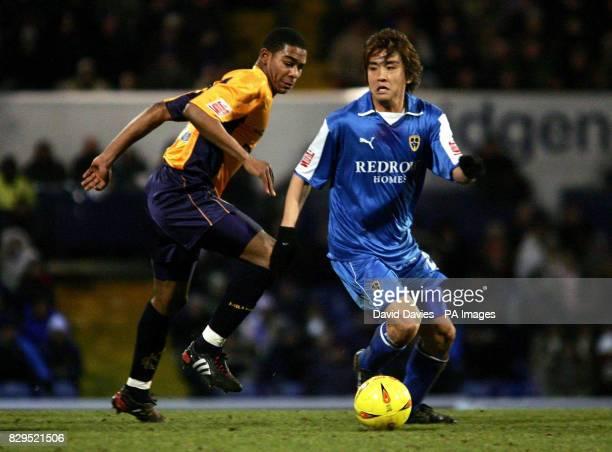 Cardiff City's Junichi Inamoto gets away from Millwall's Marvin Elliott