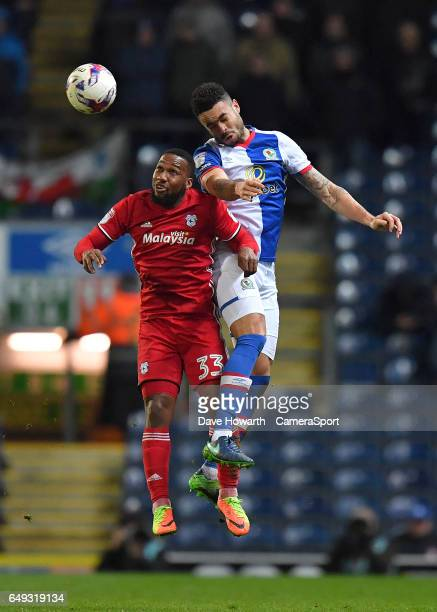 Cardiff City's Junior Hoilett and Blackburn Rovers' Derrick Williams jump for the ball during the Sky Bet Championship match between Blackburn Rovers...