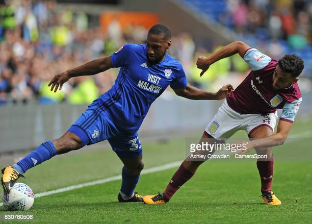 Cardiff City's Junior Hoilett vies for possession with Aston Villa's Neil Taylor during the Sky Bet Championship match between Cardiff City and Aston...