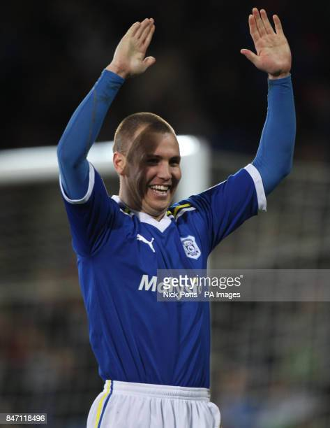 Cardiff City's Kenny Miller celebrates the opening goal scored by Peter Whittingham direct from a corner during the npower Football League...