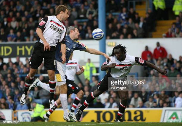 Cardiff City's Kevin McNaughton and Charlton Athletic's Linvoy Primus and Luke Varney during the CocaCola Championship match at Ninian Park Cardiff