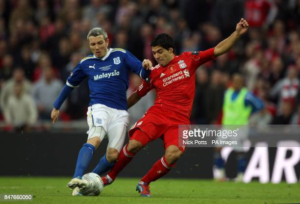 Cardiff City's Kevin McNaughton and Liverpool's Luis Suarez battle for the ball