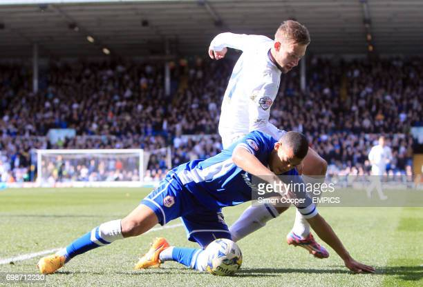 Cardiff City's Lee Peltier and Leeds United's Charlie Taylor battle for the ball