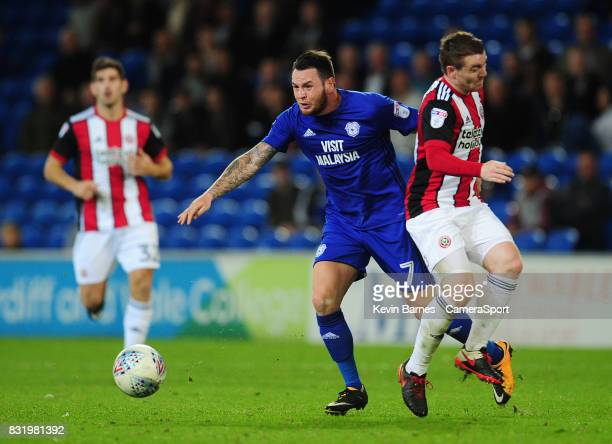 Cardiff City's Lee Tomlin is fouled by Sheffield United's John Fleck during the Sky Bet Championship match between Cardiff City and Sheffield United...