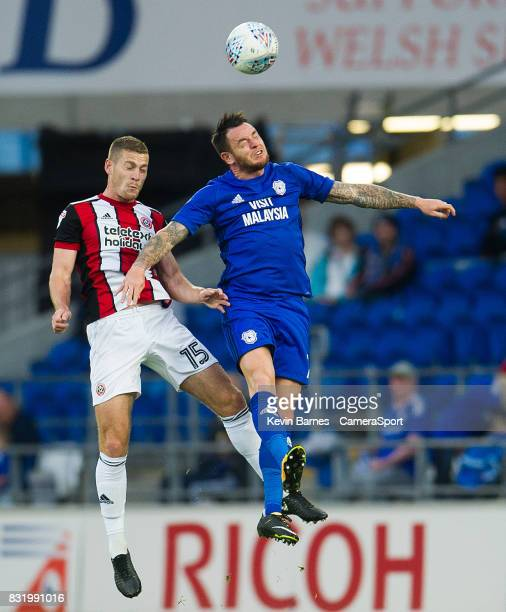Cardiff City's Lee Tomlin vies for possession with Sheffield United's Paul Coutts during the Sky Bet Championship match between Cardiff City and...