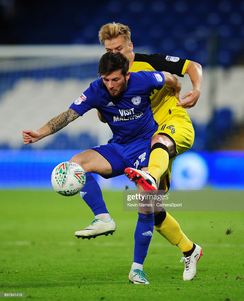 Cardiff City's Matthew Kennedy under pressure from Burton Albion's Damien McCrory during the Carabao Cup Second Round match between Cardiff City and Burton Albion at Cardiff City Stadium on August 22, 2017 in Cardiff, Wales.