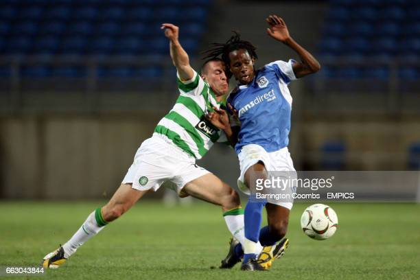 Cardiff City's Miguel Comminges and Celtic's Scott Brown battle for the ball
