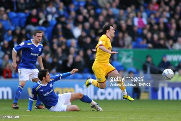 Cardiff City's Peter Whittingham and Burnley's Ross Wallace battle for the ball