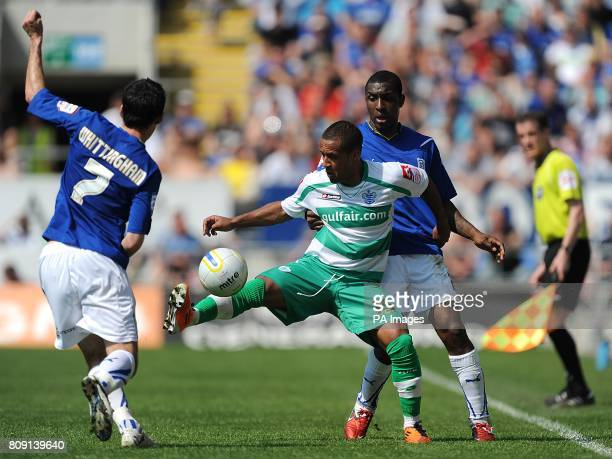 Cardiff City's Peter Whittingham and Jlloyd Samuel battle for the ball with Queens Park Rangers' Wayne Routledge